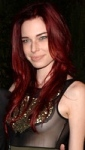 Actress Chloe Dykstra shows boobs in see-through top at Comic Con