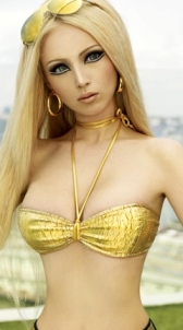 Extreme curves of real life Barbie doll Valeria Lukyanova. Blonde hair big blue eyes big boobs tiny waist