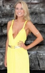 Kimberley Garner showing off cleavage in plunge front yellow dress at Lone Ranger premiere