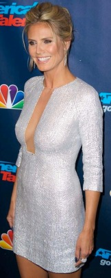 Heidi Klum shows cleavage and sideboob in revealing very low-cut dress