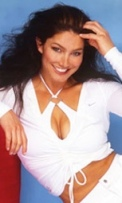 Jet from Gladiators shows off cleavage in low-cut white top