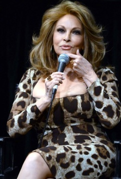 Raquel Welch - sexy older woman shows off big cleavage.