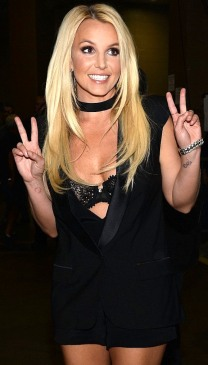 Britney looking hot in little shorts and black open tuxedo showing lace bra at iHeartRadio Festival in Las Vegas