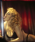 Elizabeth Berkley shows her boobs and licks a pole in Showgirls