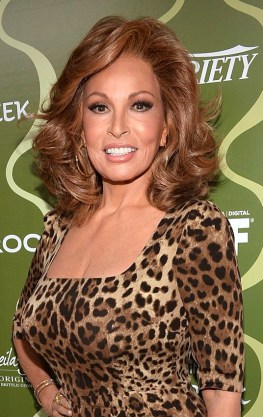 Raquel Welch in leopard print dress at Pre Emmys party. Hot older woman of 73 shows off great boobs.
