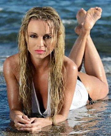 Sexy Ola Jordan in 2014 calendar wet-look shot on beach. View down cleavage.