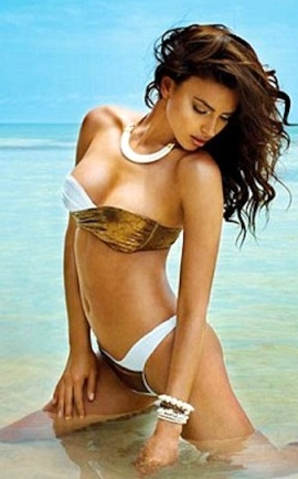 Sexy Russian model Irina Shayk in swimsuit on tropical beach