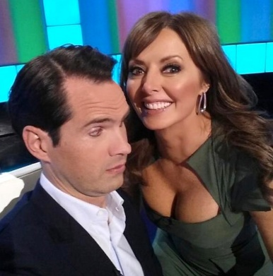 Carol Vorderman shows off great cleavage to Jimmy Carr on 8 out of 10 cats.