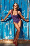 Cheryl Cole 2014 Calendar - blue and red retro swimsuit photo