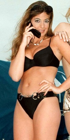 Claudia Winkleman in bikini showing boobs, legs, bum and tummy in publicity shoot for Motorola phone launch in the 1990's