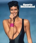 Elle Macpherson shows big cleavage in 1990 Sports Illustrated Swimsuit Issue