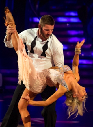 Kristina Rihanoff almost has her breasts escape from her dress as rugby star Ben Cohen looks on