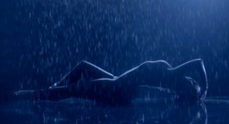 Demi Lovato hot wet photo in rain arching back from Neon Lights video