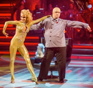 Iveta Lukosiute in sexy catsuit and Mark Benton as baddie - pussy on show in background
