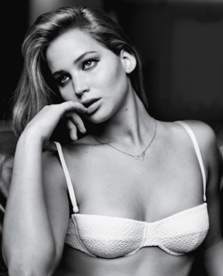 Jennifer Lawrence with white bra and finger in mouth in black and white photo for GQ