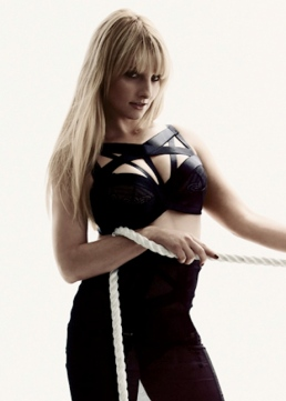 Melissa Rauch shows off her boobs in dominatrix clothing for Maxim 2013