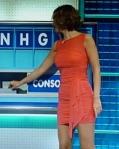Rachel Riley looking hot on Countdown in tight little orange mini