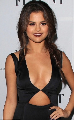 Selena Gomez shows cleavage in revealing black dress