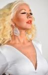 Voluptuous Christina Aguilera shows her nipples through sexy white gown at 2013 AMAs
