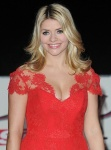 Holly Willoughby shows off plenty of famous cleavage in plunge front red dress at 2013 Military Awards