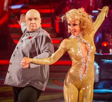 Mark Benton and Iveta Lukosiute - Iveta wearing tight gold revealing catsuit