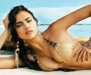 Hot Irina Shayk shows off cleavage in gold bikini for new Beach Bunny collection