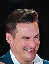 Lee Ryan smiling after being handcuffed to busty Casey Batchelor on CBB