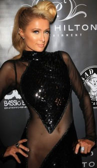Paris Hilton wears dress with nude see-through section that threaten to reveal crotch