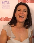 Susanna Reid shows cleavage in white dress at 2014 NTAs