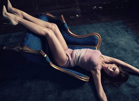 Victoria Beckham leans back with nude legs and high heels in Vanity Fair photo 2014