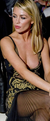 Abbey Clancy has a wardrobe malfunction - nipslip at London Fashion Week show 2014