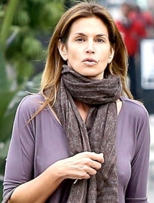 Braless Cindy Crawford shows stiff nipples under top - Feb 2014