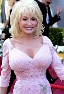 Dolly Parton huge breasts and cleavage and tiny waist