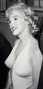 Marilyn Monroe in previously unreleased photo from Hollywood party in 1960 - pointy boobs in white dress