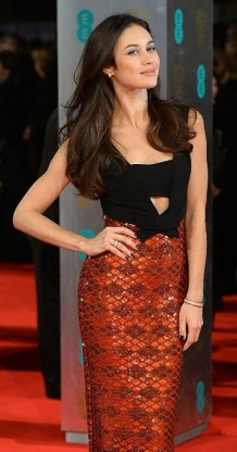 Sexy French actress Olga Kurylenko at 2014 BAFTAs