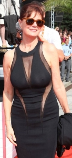 Susan Sarandon shows boobs through black see-through dress. Hot older woman with natural breasts. 65 years old.