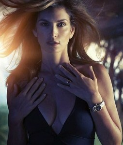 48 year old Cindy Crawford looking hot showing nipples through swimsuit as she models Omega watches