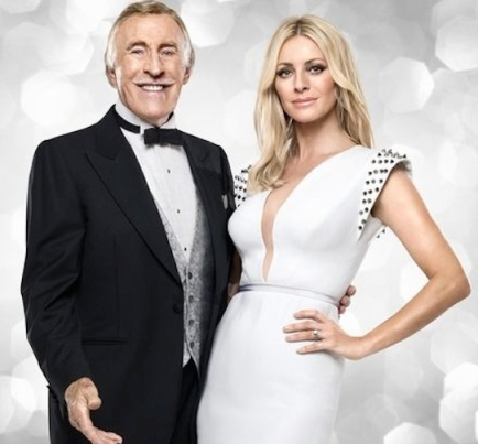 Bruce Forsyth with Tess Daly in cleavage revealing white gown