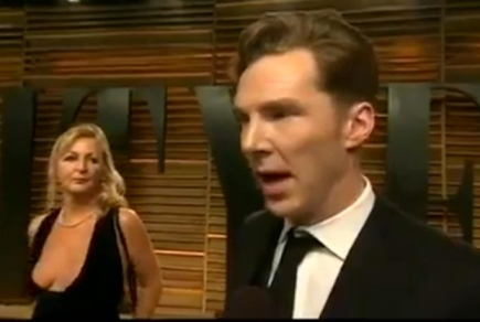 Benedict Cumberbatch photobombed by minder flashing her cleavage