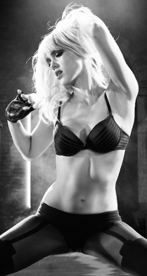 Jessica Alba as stripper Nancy wearing black bra and stockings in Sin CIty 2