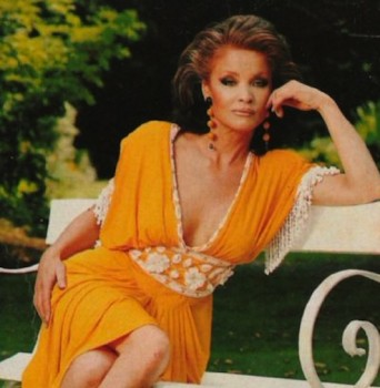Kate O'Mara shows cleavage in plunge front dress