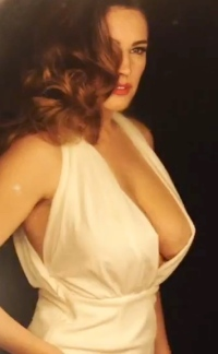 Kelly Brook shows boobs and nipples in sexy open dress for new video to promote her Audtition perfume