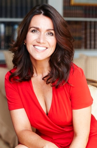 Smiling Susanna Reid shows cleavage in low-cut red dress