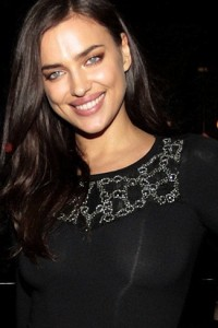Irina Shayk shows her boobs as dress goes see-through under camera flash