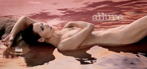 Minnie Driver nude photo in Allure - nipple showing