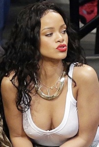 Rihanna shows nipples in white see-through top