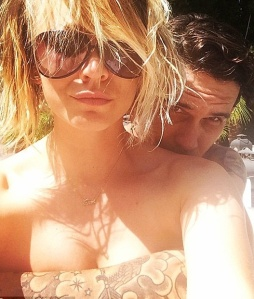Topless Kaley Cuoco from Big Bang Theory posing with husband's tatttooed arm covering her breasts