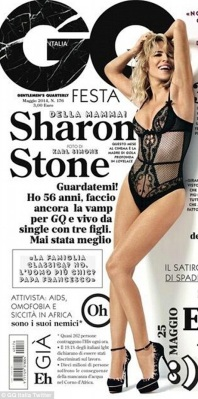 56-year old Sharon Stone shows legs and cleavage in see-through black fishnet bodysuit on GQ Italia cover May 2014