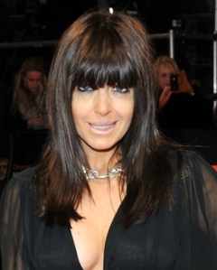 Claudia Winkleman with long fringe shows cleavage in sexy black dress