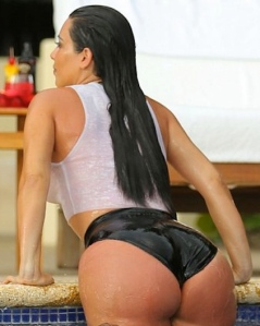 Kim Kardashian in wet look t-shirt showing big booty from behind